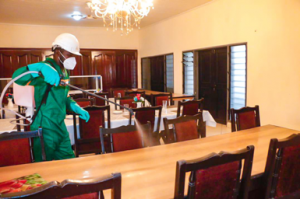 A staff of Zoomlion disinfecting the Mess at the College